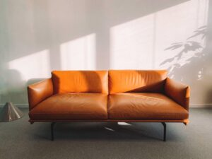 An orange leather sofa that may have a lice infestation